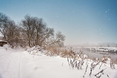 Winter misty river. Snow and frost. Overcast snowy weather. Royalty Free Stock Image