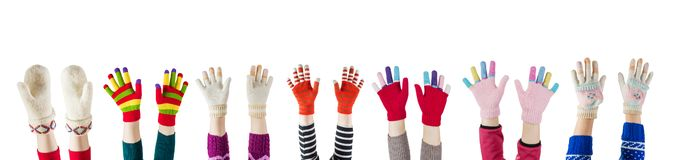 A winter mittens and gloves isolated on white background. Winter mittens and gloves isolated on white background stock photo