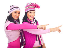 Winter models women pointing to copy space royalty free stock photo