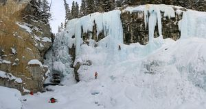 Panorama on Johnston Canyon`s Upper falls with ice climbers , bow river, alberta Canada. During the winter months December to April, Johnston Canyon is a royalty free stock photo