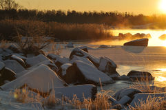 Winter morning. Early morning at the coast in wintertime Stock Image