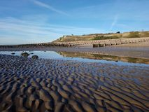 Winter Morning - Bexhill Beach. A beautiful winter morning taken at low tide on the beach at Bexhill-on-Sea in East Sussex, England with Galley Hill in reflected Stock Photo
