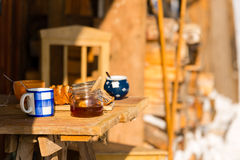 Winter morning breakfast outside wooden cottage Stock Photo