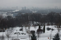 Winter morning in city. Buildings are hiding in the fog on the left bank of the Dnipro. View from Park Vіchnoj Slavi. Royalty Free Stock Photos