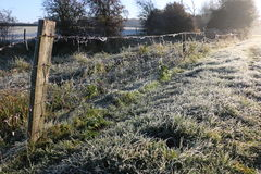 Winter morning in the countryside. A frosty winter`s morning in the English countryside with the sun rising off the fields Royalty Free Stock Photo
