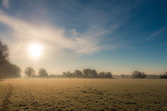Winter morning in the countryside. A frosty winter`s morning in the English countryside with the sun rising off the fields Stock Photo