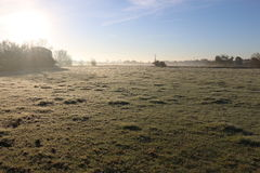 Winter morning in the countryside. A frosty winter`s morning in the English countryside with the sun rising off the fields Stock Image
