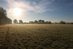 Winter morning in the countryside. A frosty winter`s morning in the English countryside with the sun rising off the fields Stock Photos