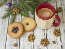 Winter morning, cup of coffee with knitted cup holders, gingerbread cookies with fir tree branches decorated with spruce stock photos