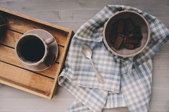 Winter morning at home, chocolate and coffee in cup with napkin on grey wooden table Stock Photos