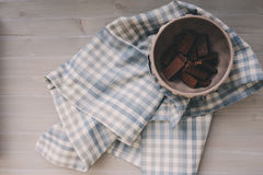 Winter morning at home, chocolate in cup with napkin on grey wooden table Stock Photography