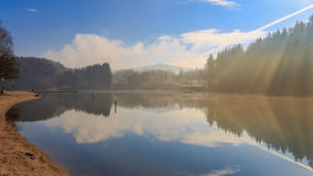 Winter Morning at the Lake Eging. Sunbeams at the lake on a cold winter morning in Eging am See in the bavarian forest Stock Photos