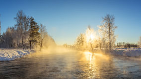 Winter morning landscape with mist on the river with the forest, Russia, the Urals Stock Image