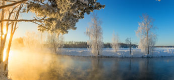 Winter morning landscape with mist on the river with the forest, Russia, the Urals Stock Images