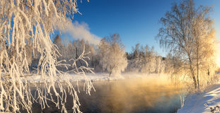 Winter morning landscape with mist on the river with the forest, Russia, the Urals Royalty Free Stock Image