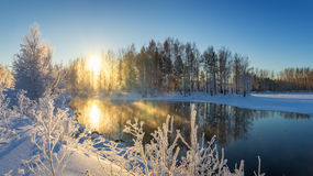 Winter morning landscape with mist on the river with the forest, Russia, the Urals Stock Photo