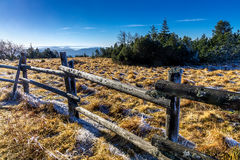 Winter morning. Landscape photo: View to the mountains of the Black Forest on a cold winter morning with fence in the foreground royalty free stock images