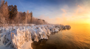 Winter morning landscape on the river with the fog, Russia, Ural Royalty Free Stock Image