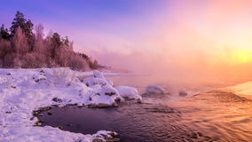 Winter morning landscape on the river with the fog, Russia, Ural Stock Image