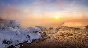 Winter morning landscape on the river with the fog, Russia, Ural Stock Photos
