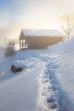 Winter morning with a log cabin Stock Photos