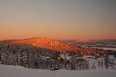 Winter morning mountain scenery. View from the ski slope Jaervsoebacken on mountain Oejeberget, Sweden royalty free stock image