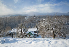 A winter morning in the mountain village Mezmay Stock Photography