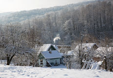A winter morning in the mountain village Mezmay Stock Images