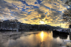 Winter morning river Amstel. Beautiful winter panorama of the river Amstel and the skinny bridge in Amsterdam, the Netherlands. HDR Royalty Free Stock Photos