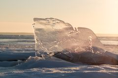 Winter morning on the river. Frozen ice on the river Volga in the rays of the rising sun Royalty Free Stock Image