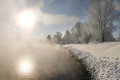 Winter morning on the river. Winter landscape misty morning on the river at sunrise Royalty Free Stock Photo