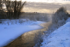 Winter morning on the river. Scenic winter landscape river and trees consecrated rising sun Royalty Free Stock Image