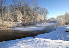 Winter morning on the river. Scenic winter landscape river and trees consecrated rising sun Royalty Free Stock Photos