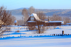 Winter morning in Russian old-believer village Visim. Ural, Russia. Early winter morning in Russian old-believer village Visim, situated in the low Middle Ural royalty free stock image