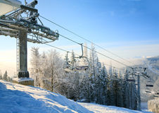 Winter morning and ski lift Royalty Free Stock Photo