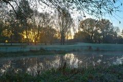 Sunrise over a golf club in Cambridgeshire UK. Winter morning sunrise in a frosty UK Stock Image
