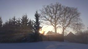 Winter morning sunrise in village. Early winter morning sunrise in village stock video footage