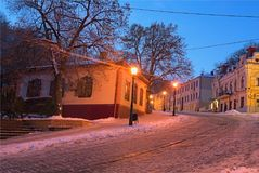 Winter morning view of colourful buildings on empty Andriyivskyy Uzvoz Descent or Spusk. One of the oldest street in Kyiv.  royalty free stock photos