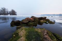 Winter morning view to the Dnipro River in winter. After a cold snap came a thaw. Ice on the river quickly melts and already water is clearly visible. Kyiv Royalty Free Stock Images