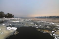Winter morning view to the Dnipro River in winter. After a cold snap came a thaw. Ice on the river quickly melts and already water is clearly visible. Kyiv Royalty Free Stock Photo