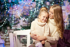 Winter mother and daughter. Smiling woman and child. Cute girl w Royalty Free Stock Images