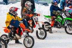 Winter Motocross competitions among children Royalty Free Stock Photography