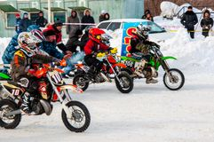 Winter Motocross competitions among children. 10.03.2013, city of Orenburg, Southern Ural, Russia Royalty Free Stock Photos