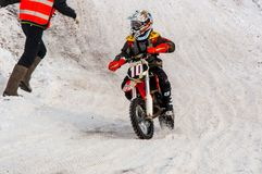 Winter Motocross competitions among children. 10.03.2013, city of Orenburg, Southern Ural, Russia Royalty Free Stock Photo
