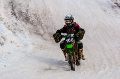 Winter Motocross competitions among children. 10.03.2013, city of Orenburg, Southern Ural, Russia Royalty Free Stock Photography