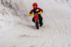 Winter Motocross competitions among children. 10.03.2013, city of Orenburg, Southern Ural, Russia Stock Image