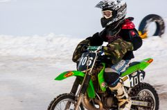 Winter Motocross competitions among children Royalty Free Stock Photo