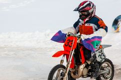 Winter Motocross competitions among children. 10.03.2013, city of Orenburg, Southern Ural, Russia Royalty Free Stock Images