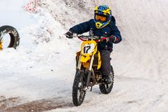 Winter Motocross competitions among children. 10.03.2013, city of Orenburg, Southern Ural, Russia Stock Photos