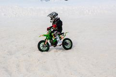 Winter Motocross competitions among children Royalty Free Stock Images